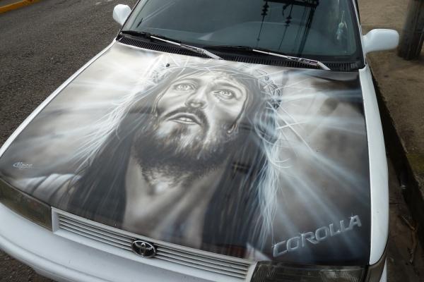 ... Jesus bonnet on toyota corolla