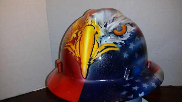 Custom painted hard hat, customer wanted an American/Mexican flag theme with Bald/Gold eagle front.