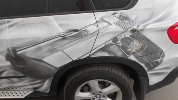 Final result: BMW E70 X5 Gets a .50 Desert Eagle Airbrushed on Its Side - Airbrush Step by Step