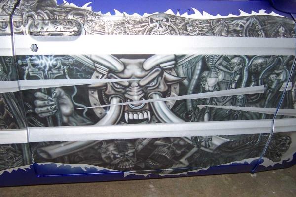 Bio mech mural on mazda pickup