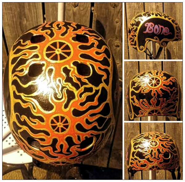 This is a helmet I painted for a local cycling shop 5 years ago, all hand-painted in acrylics, then clear coated!