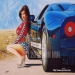 """REVVED-UP!"" (C) 2010 Jon Hul This is my airbrush painting, rendered with acrylic paints on illustration board. The model is Denise Milani, and the car is a 2009 Fort-GT Custom."