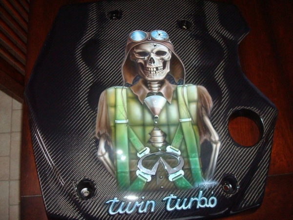 Carbon engine cover with airbrush