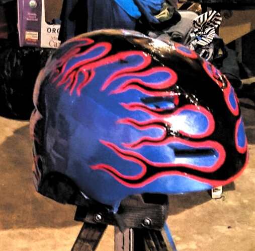 This helmet was in really rough shape, I sanded it and primed it repainted using spray paint for the base color, then hand-painted the flames