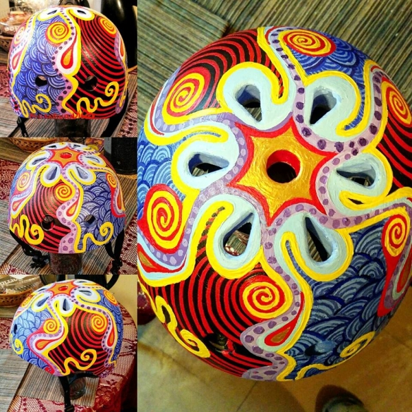 "This child's helmet is called "" Color Spin "" it took me 2 weeks to hand paint this, it was done in acrylics and clear-coat"