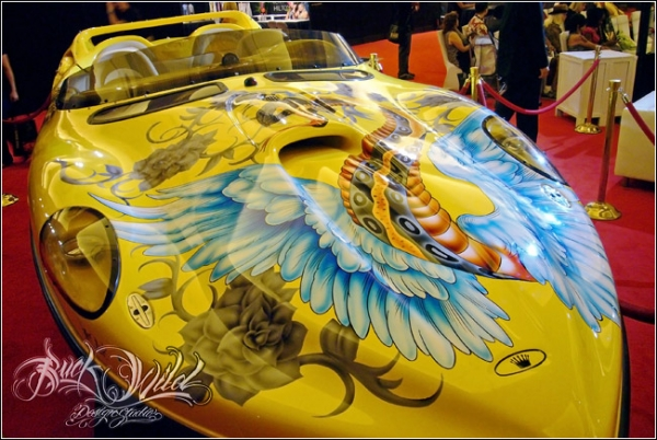 Buckwild Designs - Christian Audigier Custom Boat